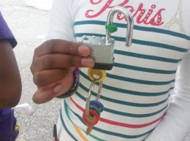 Image of student unlocking a lock as part of a Healthy Futures activity