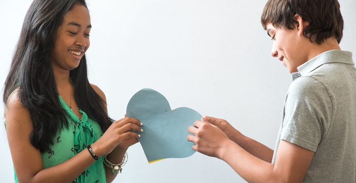 Picture of a female and male student doing the Healthy Futures heart activity.